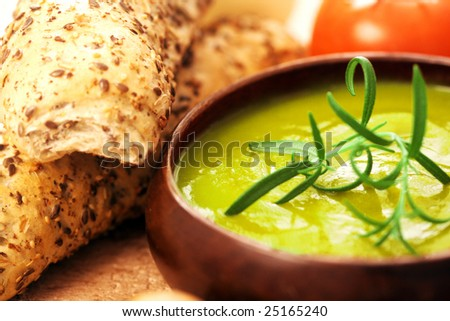 cream of broccoli soup. vevetable soup with rosemary as garnish - stock photo