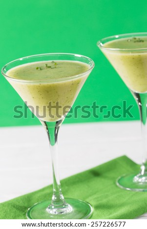 Cream of fresh zucchini served in cocktail glasses - stock photo