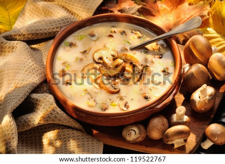Cream of mushroom soup. Home-made, country style with whole and sliced mushrooms. - stock photo