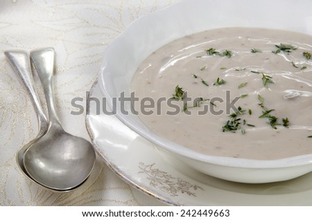 cream of mushroom soup with fresh thyme - stock photo