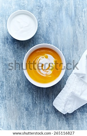 Cream of pumpkin soup with cream cheese - stock photo