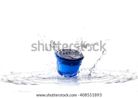 Cream pot and water splash. Concept beauty and fresh - stock photo