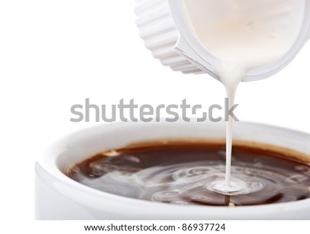 cream poured in coffee isolated on a white background - stock photo