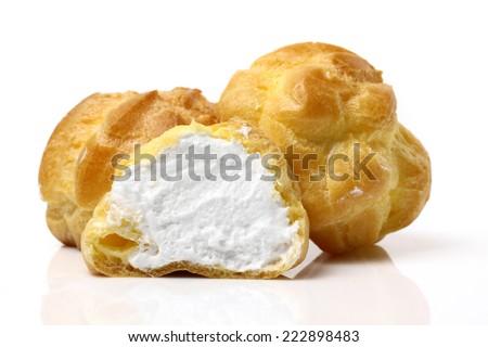 Cream puffs on white background  - stock photo