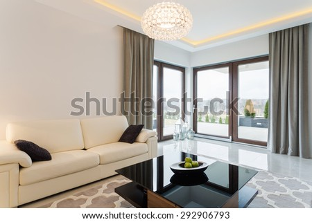 Cream sofa in bright living room interior - stock photo