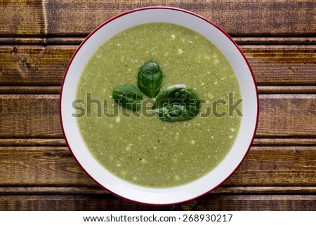 Cream soup fresh spinach in a white plate. - stock photo