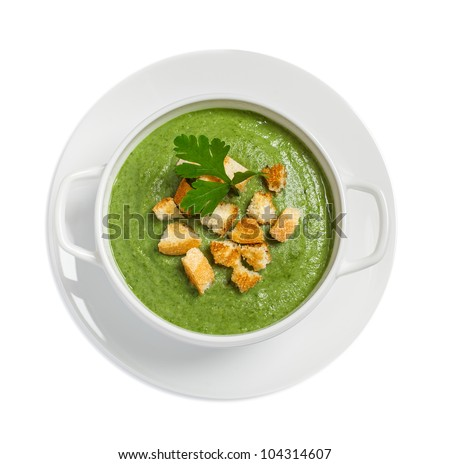 Cream soup with dried crusts isolated on white, studio shot - stock photo