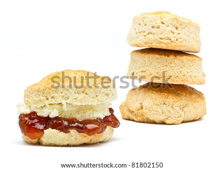 Cream tea Scone with jam from low perspective isolated on white. - stock photo