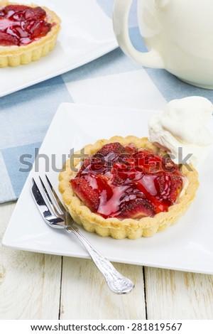Cream tea - strawberry tarts - stock photo