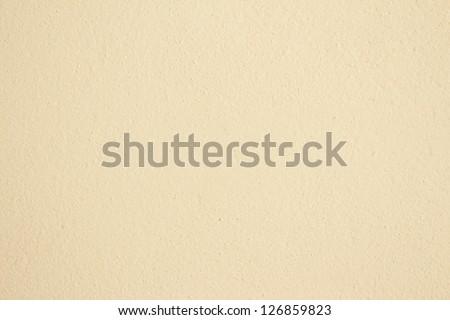 Cream textured wall - stock photo