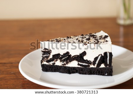 Creamy cheesecake with chocolate cookies and cream biscuits.  - stock photo