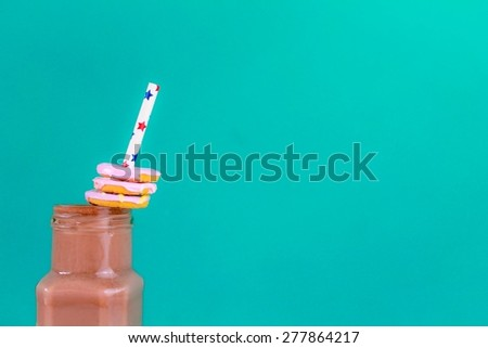 Creamy Chocolate Milkshake with iced ring cookies - stock photo
