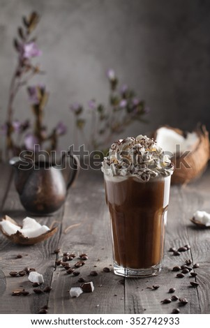 Creamy coffee with coconut in a glass - stock photo