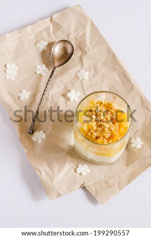 creamy dessert with caramelized pears and nuts in the glass. toning. selective focus on pear - stock photo
