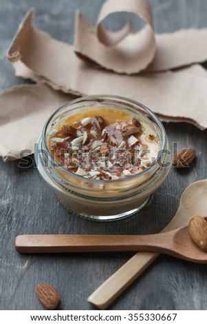 Creamy homemade cheesecake with salted caramel and chopped almond - stock photo