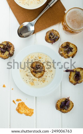 Creamy onion - garlic soup, toast with melted cheese and caramelized onions - stock photo