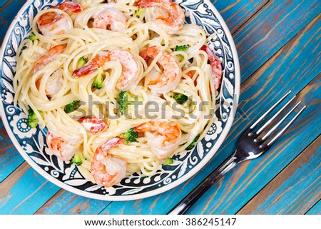 Creamy Shrimp and Broccoli Spaghetti. View from above, top studio shot - stock photo