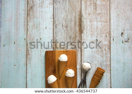 creamy vanilla ice cream in preparation with rustic background and copyspace   - stock photo