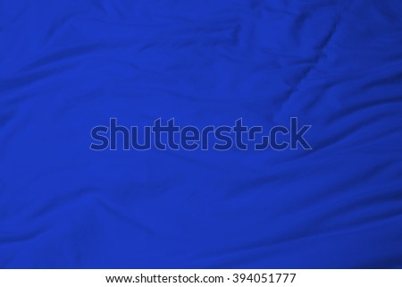 creased blue cloth material fragment as a background. - stock photo