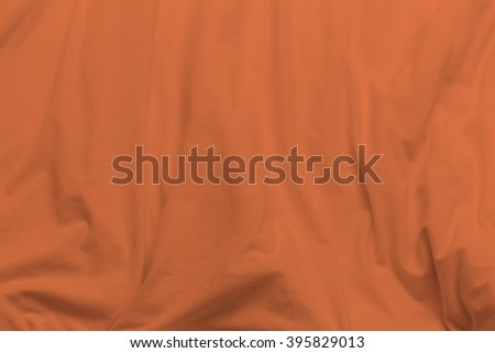 creased colorful cloth material fragment as a background. - stock photo