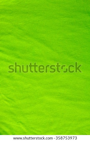 Creased green cloth material fragment as a background - stock photo
