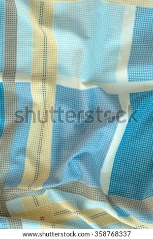 Creased plaid blue cloth material fragment as a background - stock photo