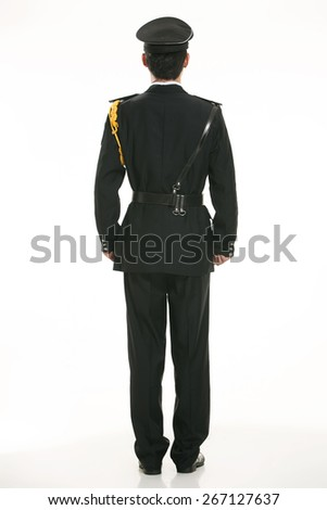 Create all kinds of work clothes policeman stands in front of a white background - stock photo