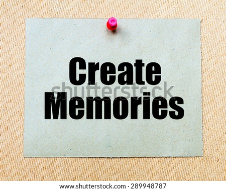 Create Memories written on paper note pinned with red thumbtack on wooden board. Motivation conceptual Image - stock photo