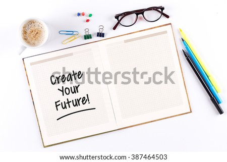 Create Your Future! text on notebook with copy space - stock photo