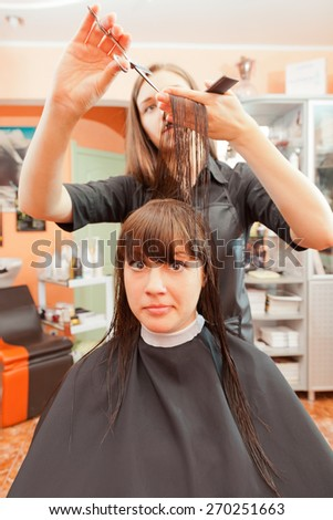 creating hairstyles hairdresser at salon. indoor shot - stock photo