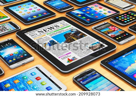 Creative abstract mobility and digital wireless communication technology business concept: group of tablet computer PC and modern touchscreen smartphones or mobile phones on wooden table - stock photo
