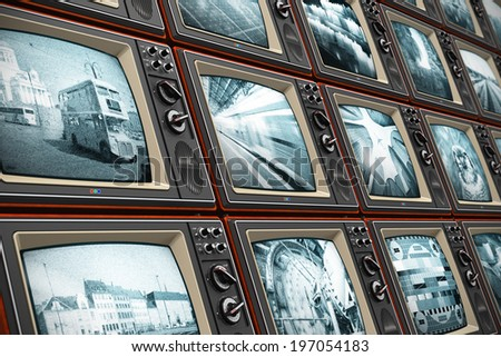 Creative abstract television broadcasting, news media, business, entertainment and cinema concept: wall of old wooden black and white TV screens with various broadcast channels - stock photo