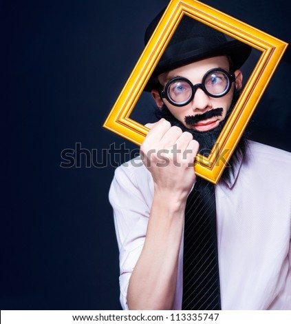 Creative Artistic Man Thinking Outside Of The Rectangular Square While Looking Through A Picture Frame In A Depiction Of A Social Media Profile Picture - stock photo