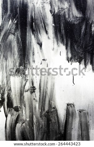 Creative background careless brush strokes dark paint, abstract textured background with flares and cracks. Grungy surface. Great background or texture for your project. - stock photo