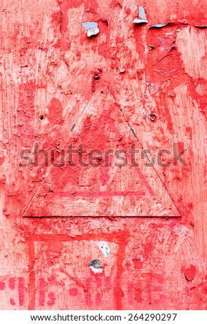 Creative background metal triangle cracks and scratches carelessly painted with red paint. Textured background for your concept or project. Great background or texture. - stock photo