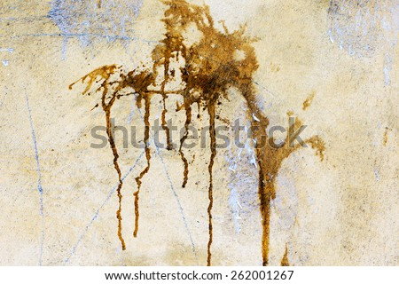 Creative background yellow concrete wall with cracks and scratches doused with brown paint splashes and drips. For creative unusual vintage design - stock photo