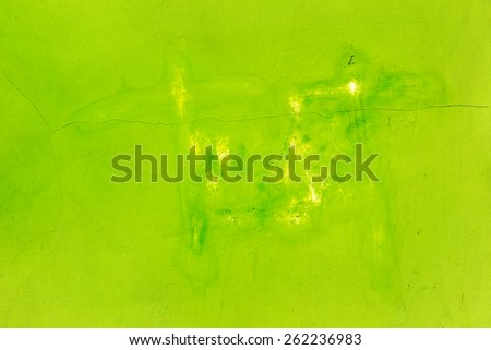Creative beautiful bright green background, cracks and scratches on the concrete. Grungy concrete surface. Great background or texture for your project. - stock photo