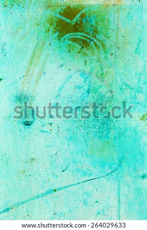 Creative beautiful green background, blue spray paint on concrete with cracks and scratches. Landscape style. Grungy concrete surface. Great background or texture. - stock photo