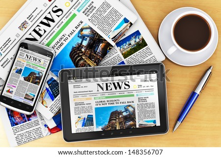 Creative business corporate work concept: tablet computer, touchscreen smartphone with news internet web site, stack of newspapers, cup or mug of fresh coffee and metal ballpoint pen on office table - stock photo