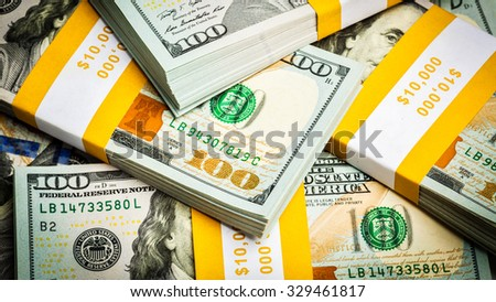 Creative business finance making money concept - panoramic bacgkround of new 100 US dollars 2013 edition banknotes (bills) bundles close up - stock photo