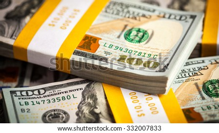 Creative business finance making money concept - panoramic background of new 100 US dollars 2013 edition banknotes (bills) bundles close up - stock photo