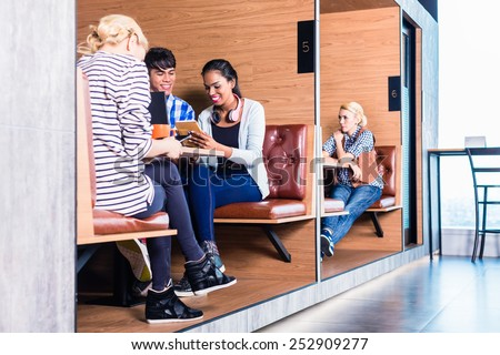 Creative business people in coworking space having meetings in cubicle offices - stock photo