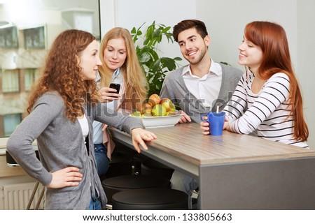 Creative business team taking a break in social room - stock photo