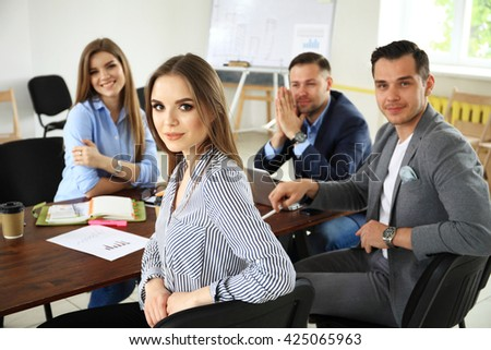 Creative business team working hard together in casual office - stock photo
