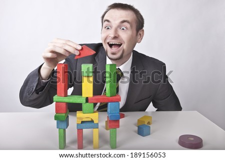 Creative businessman plays in the office - stock photo