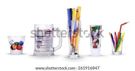 creative cocktail is made of handles and multi-colored materials in glasses - stock photo