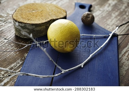 creative composition of lemon laying on the old wooden surface - stock photo