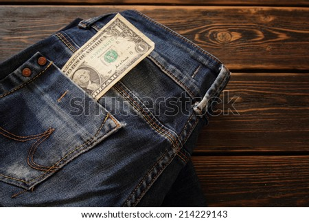 Creative composition of Money on the jeans idea - stock photo