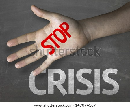 Creative composition with the message Stop Crisis - stock photo