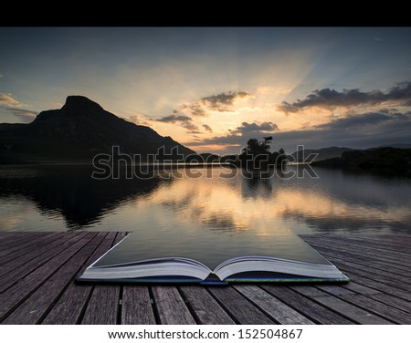 Creative concept pages of book Beautiful sunrise mountain landscape reflected in calm lake - stock photo